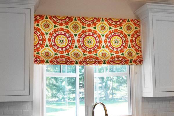 Colorful Roman shade in a home kitchen