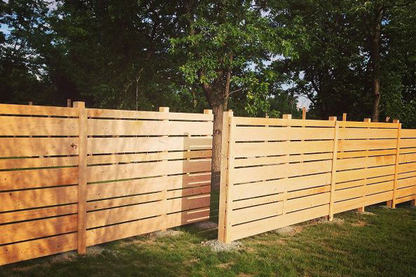 DIY wood fence in a yard