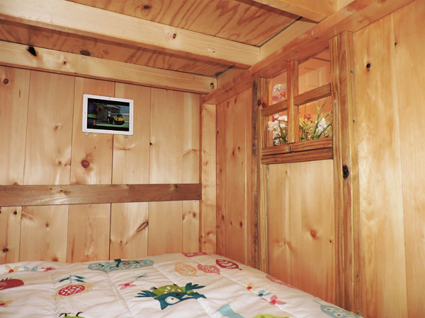 Inside the bottom bunk of the fairytale bunkbed