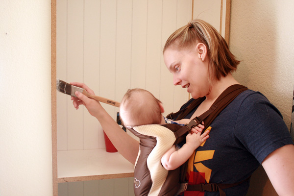 Painting with the baby in a Baby Bjorn