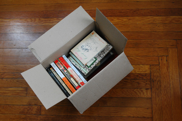 Books packed in a moving box