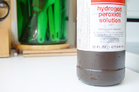 Bottle of hydrogen peroxide sits on a table