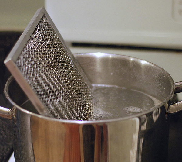 boil your range filter to clean it