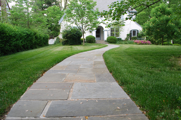 Stone walkway to suburban home