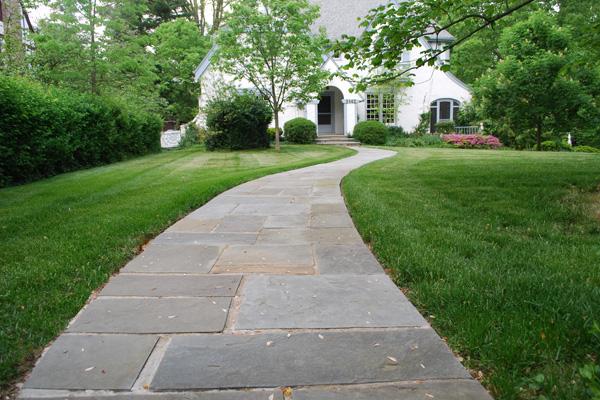 Stone walkway to suburban home