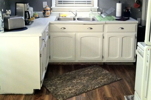 Kitchen cabinets painted white with beadboard