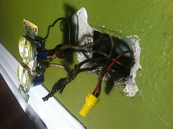 Botched electrical work in a home wall outlet