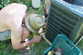 Fixing a home air conditioner on a hot day