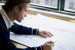 Architect studying home remodeling plans