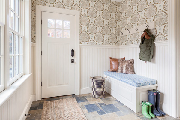 Well-organized mudroom with wainscoting