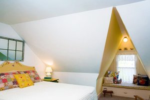 Window seat in attic bedroom | Attic remodel