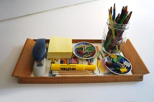 A tray holding school supplies