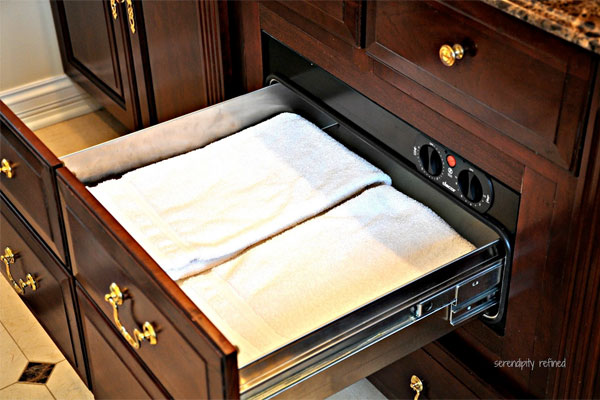 Towel warming drawer in a home's bathroom