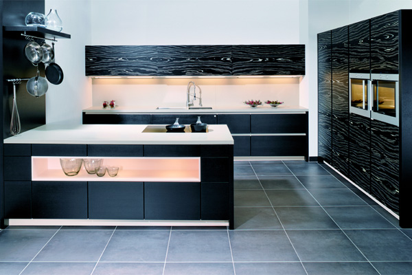 A black and white kitchen with stainless steel appliances