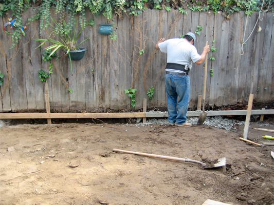 Man working on exterior French drain