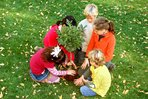 Children planting a tree on Earth Day