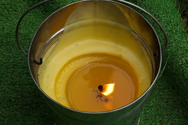 A citronella candle on a home patio