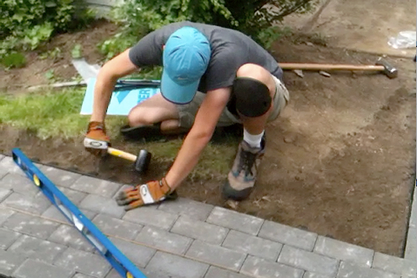 Working on the new paver walkway