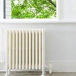 Cast iron radiator next to window