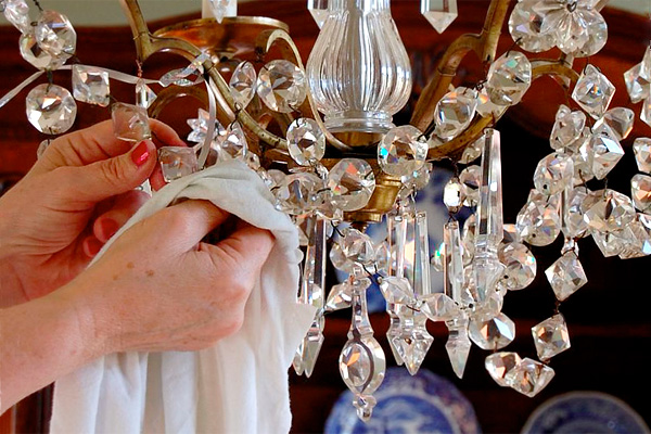 Cleaning a chandelier in a home