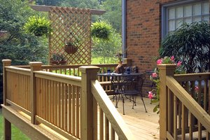 Adding a deck to your home home deck additions houselogic for How do you build a deck yourself