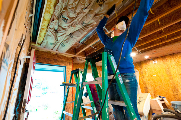 Adding insulation to a home's ceiling