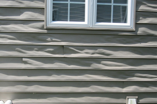 Vinyl siding melted by low-e windows