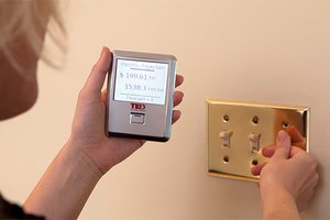 Homeowner with handheld energy usage monitor