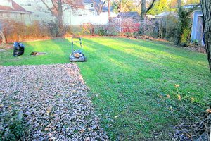 Mulching fall leaves using a lawn mower