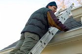 fall-maintenance-man-cleaning-gutters-getty