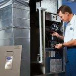 Serviceman performing fall furnace checkup