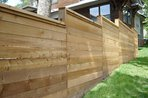 Wooden fence in yard of residence