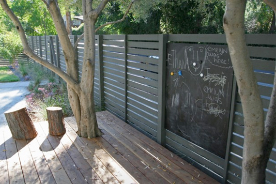 A chalkboard adorns this adorable fence