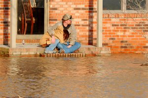 Residents in flooded Dutchtown, Missouri