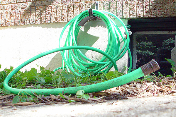 Garden hose outside a house