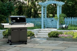 Gas grill in back yard