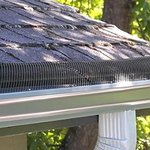 Custom-made gutter covers keep the leaves out
