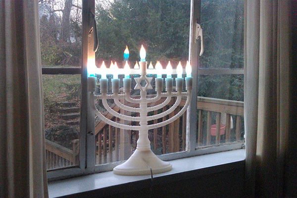An electric menorah in a window