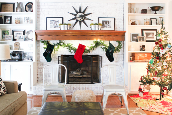 Living room with a fireplace decorated for Christmas