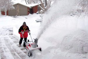 Person using a snow blower at home