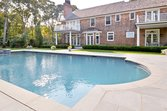 Inground pool behind lovely home