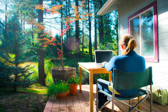 Woman Working on a Laptop Outdoors | Home Office Deductions
