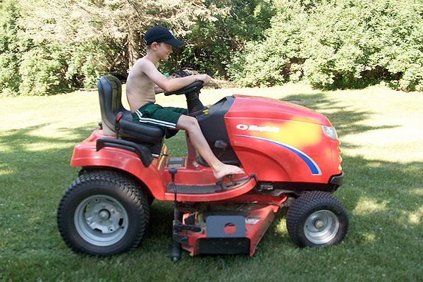 12-year-old boy on a riding mower