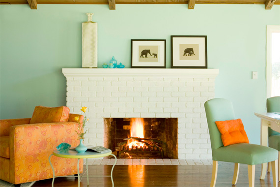 Wall color contrasts with this white-painted fireplace