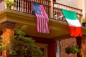 A home with the U.S. and Italian flags displayed