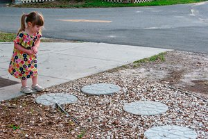 Homemade stepping stones in a home's yard
