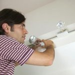 Man adjusting track lighting
