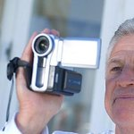 Man using a camcorder to record home inventory