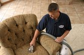 man-cleaning-upholstered-chair-chemdry