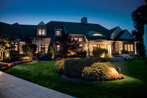 Dramatic landscape lighting outside house